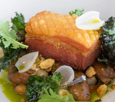 Crispy Pork Belly , BBQ baked shelling beans, quince mustard, pistachio, crispy brassicas