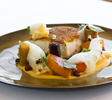 Northern Halibut , butternut squash agnolotti, roasted Chino Farms carrots, sesame granola, pomegranate catsup, curry