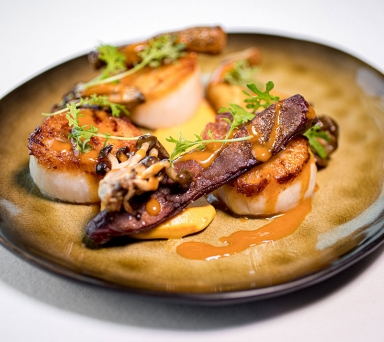 Seared Scallops, sweet potato, beech mushrooms, Chino greens, hominy, spiced dried scallop broth