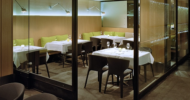 Pacific Room Glass Dividers surround tables