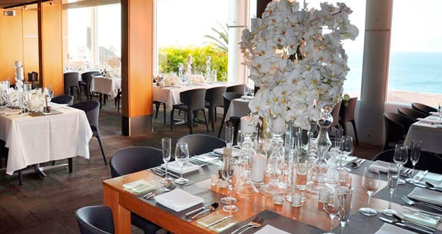 Ocean View Room & Pacific Room table setup with wedding centerpiece